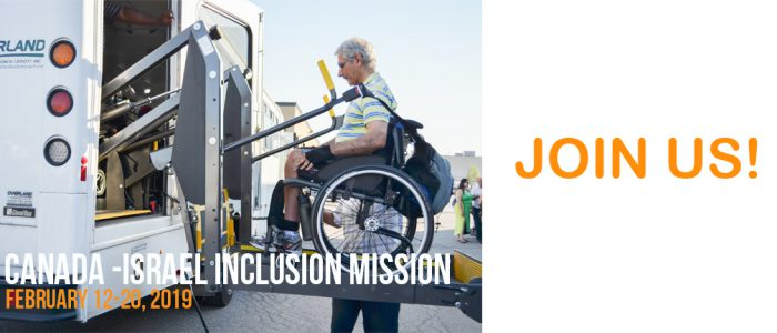 A physically challenged man being helped to board a van through the Canada-Israel Inclusion Mission
